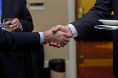 HandShake. A Picture of a handshake between to Caucasian males Royalty Free Stock Images