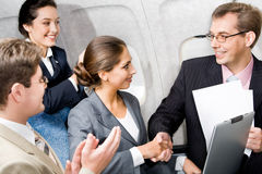 Handshake in the plane Stock Images