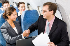 Handshake in a plane Stock Image