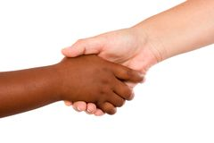 Handshake between races. A over white background Stock Image