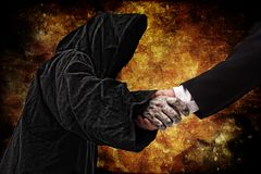 Handshake with reaper Royalty Free Stock Images