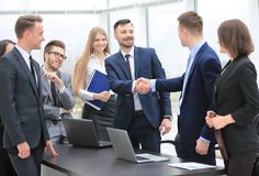 Representatives of the two business teams greet each other. Handshake between representatives of the two business teams Stock Photo