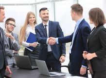Representatives of the two business teams greet each other. Handshake between representatives of the two business teams Royalty Free Stock Photos