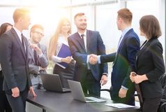 Representatives of the two business teams greet each other. Handshake between representatives of the two business teams Stock Photos
