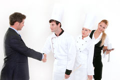 Handshake - restaurant manager and kitchen staff. Congratulation isolated on white background Stock Photos