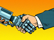 Handshake of robot and man. New technologies evolution. Handshake of robot and man. New technologies and evolution pop art retro style. Robotics. Computers and Royalty Free Stock Photos