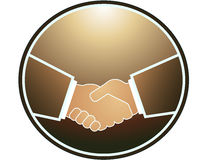 Handshake in round and light. Brown handshake in round frame and light Stock Photography