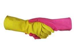 A handshake is in sanitary gloves Royalty Free Stock Images