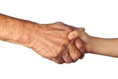 Handshake between a senior and a child Royalty Free Stock Photography