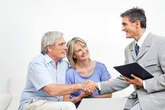 Handshake between senior couple stock photo