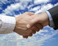 Handshake in the sky Stock Image