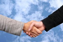 A handshake on sky background royalty free stock photography