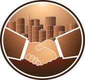 Handshake and skyscraper. Business handshake on the background of a large city Stock Images