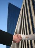 Handshake with skyscraper Royalty Free Stock Photo