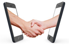 Handshake with smartphone and cell. Two hands making business handshake with smartphone and cell phone royalty free illustration