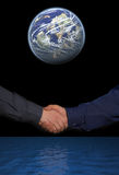 Handshake in space Royalty Free Stock Images