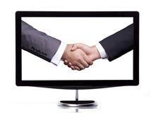 Handshake sullo schermo Immagini Stock