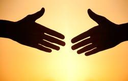 Handshake at sunset Stock Photos