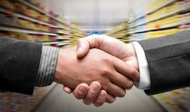Handshake at supermarket. Leaders giving handshake at supermarket Royalty Free Stock Photos