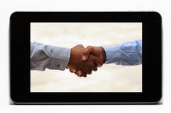Handshake on Tablet Stock Images