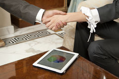 Handshake and tablet Royalty Free Stock Images