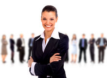 Handshake and team. Business woman leading her team isolated over a white background Royalty Free Stock Images