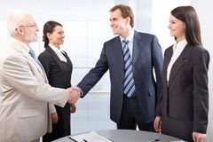Handshake and teamwork Stock Images