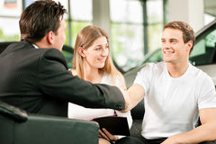 Handshake to buy that car royalty free stock images