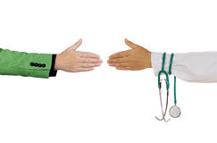 Handshake to close a deal between. Medical and business person on a white background Royalty Free Stock Photography