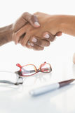 Handshake to seal a deal after a business meeting. In the office Royalty Free Stock Photos