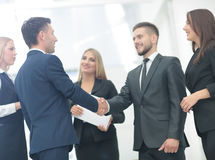 Handshake to seal a deal after a job recruitment meeting in a of Stock Photography