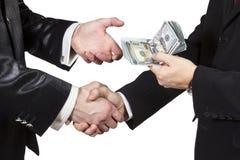 Handshake with the transfer of money Stock Photo