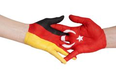 Handshake between turkey and germany Stock Photos
