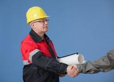 Handshake between two builders Stock Photos