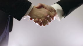 Handshake of two business people. Slow motion. Handshake of two business people stock footage