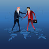 Handshake of two business people with world map background. Royalty Free Stock Photo