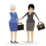 Handshake of two business women carrying briefcases. Character vector illustration people. Royalty Free Stock Photos