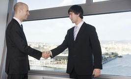 Handshake between two businessmen Stock Photos