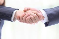 Handshake of the two businessmen Stock Photos