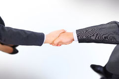 Handshake of the two businessmen Stock Photos