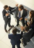 Happy successful business team giving a high fives gesture as th Royalty Free Stock Photos