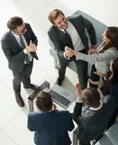 Happy successful business team giving a high fives gesture as th Royalty Free Stock Images