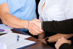 Handshake of two businessmen on the background of the Secretary Royalty Free Stock Image