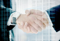 Handshake of two businessmen on a city background Stock Photography
