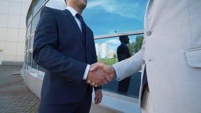 Handshake of two businessmen closeup stock footage
