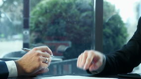 Handshake of two businessmen. Two businessmen discuss the contract sign papers and shake hands each other stock footage