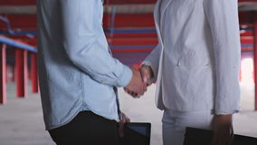 Handshake of Two Businessmen. Handshake of a girl and a man in business suits closeup stock video footage