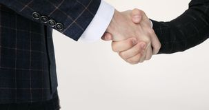 Business handshake two businessman shaking hands closeup. Handshake: two businessmen shaking hands stock footage