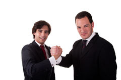 Handshake between two businessmen smilling Stock Photos