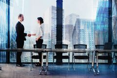 Handshake of two businessperson in office concept of partnership and teamwork. Handshake of two businessperson in a modern office. concept of partnership and Royalty Free Stock Photo